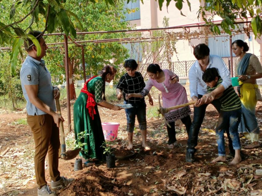 Sirat helps Kairav with a school project
