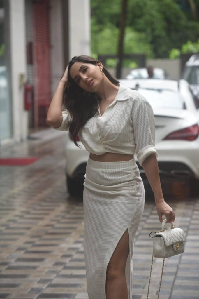 Nora Fatehi All White Outifit turn heads as she walks down the street outside a studio